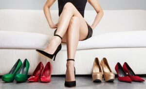 Beautiful legs. Woman with many shoes. choosing.Body care